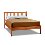Modern solid cherry wood bed with square dowel spindles on headboard, from Maine's Chilton Furniture Co.