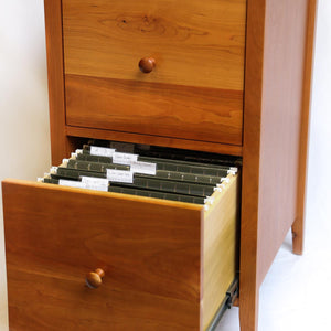 Open drawer of Shaker file office storage with green files inside