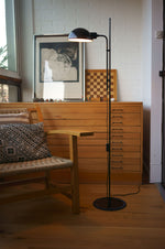 Mid-century modern office with simple floor lamp with rounded black metal shade