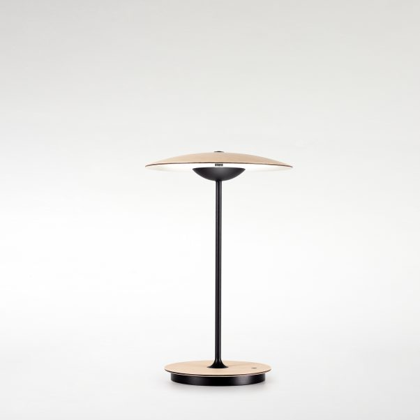 Portable Ginger table lamp in white oak with thin black stand and slightly curved shade