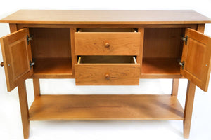Shaker style huntboard furniture made of cherry wood, with drawers and doors open to show storage space inside