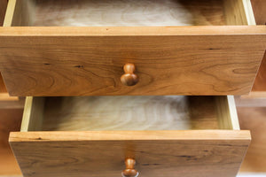 Two open drawers of Shaker Huntboard showing details of wooden drawer front and mushroom style cherry knobs