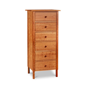 Modern interpretation of a classic Shaker style lingerie chest with six drawers and rounded legs, in solid cherry wood