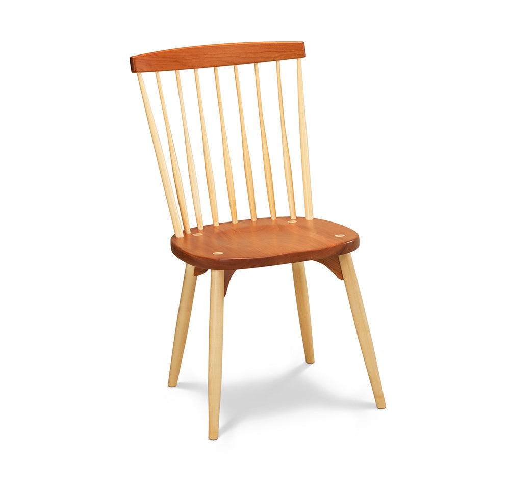 Classic spindle back chair with round tapered legs in cherry and maple