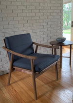 Scandinavian style Nautilus Lounge Chair with Navarend Round Side Table in walnut