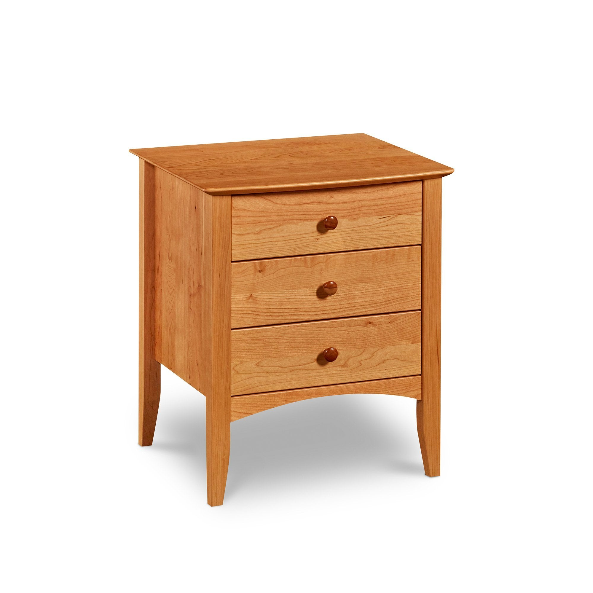 Shaker style Penobscot nightstand with three drawers, an arched apron and tapered legs, in cherry wood