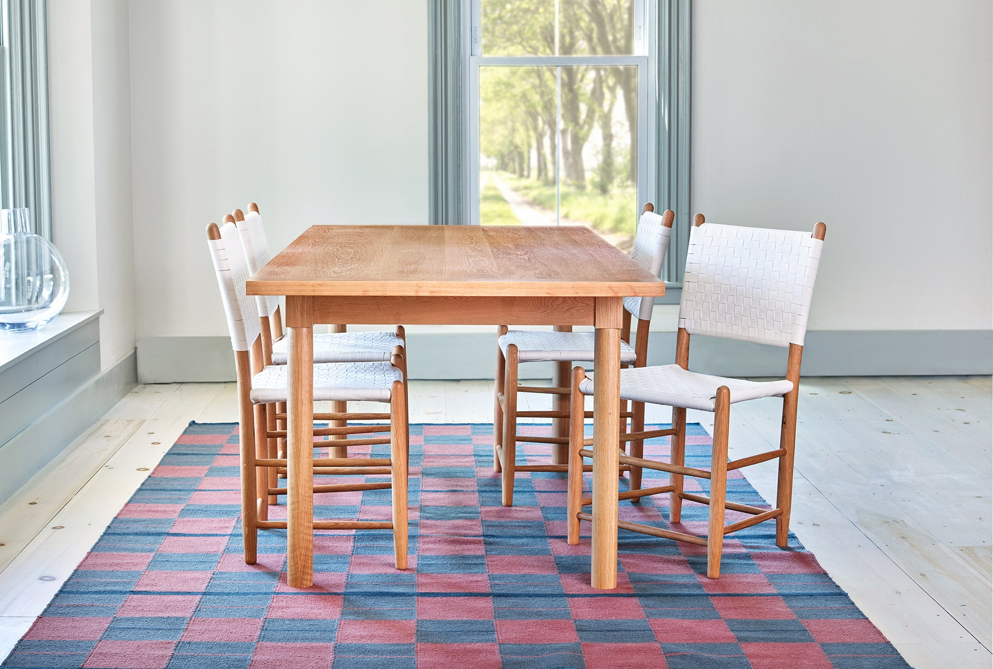 Modern dining room with white oak Revelry table and white Tappan side chairs, from Maine's Chilton Furniture Co.