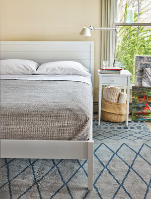 Bedroom with painted white Chilton Cottage nightstand and Shiplap bed