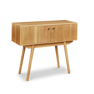 Mid-century Scandinavian inspired sideboard with angled legs in solid white oak wood