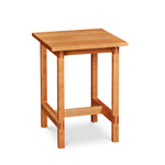 Modern trestle-style side table with visible joinery in cherry, from Maine's Chilton Furniture Co.