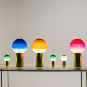 Six glass dipping lamps in green, blue, pink and amber, alternating large and small