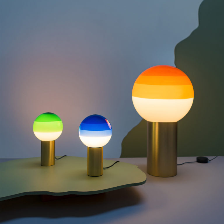 Three large and small glass dipping lamps in green, blue and amber