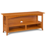 Arts & Crafts style Durham Media Console built in solid cherry wood with low shelf, arched skirt and flared legs