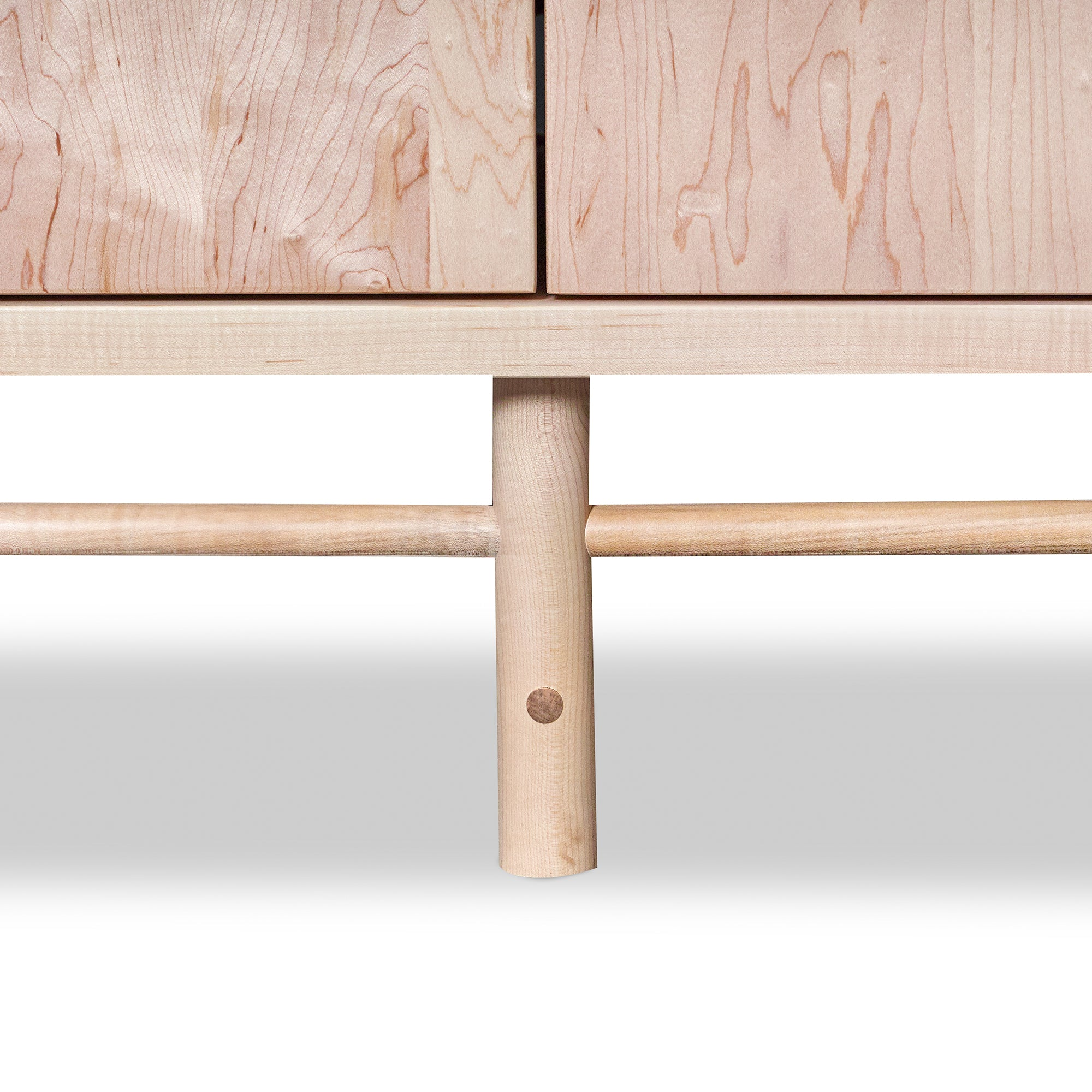 Detail of legs, stretchers and mortise and tenon joinery om solid maple wood Navarend Media Case