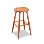Simple round solid cherry wood stool, from Maine's Chilton Furniture Co.