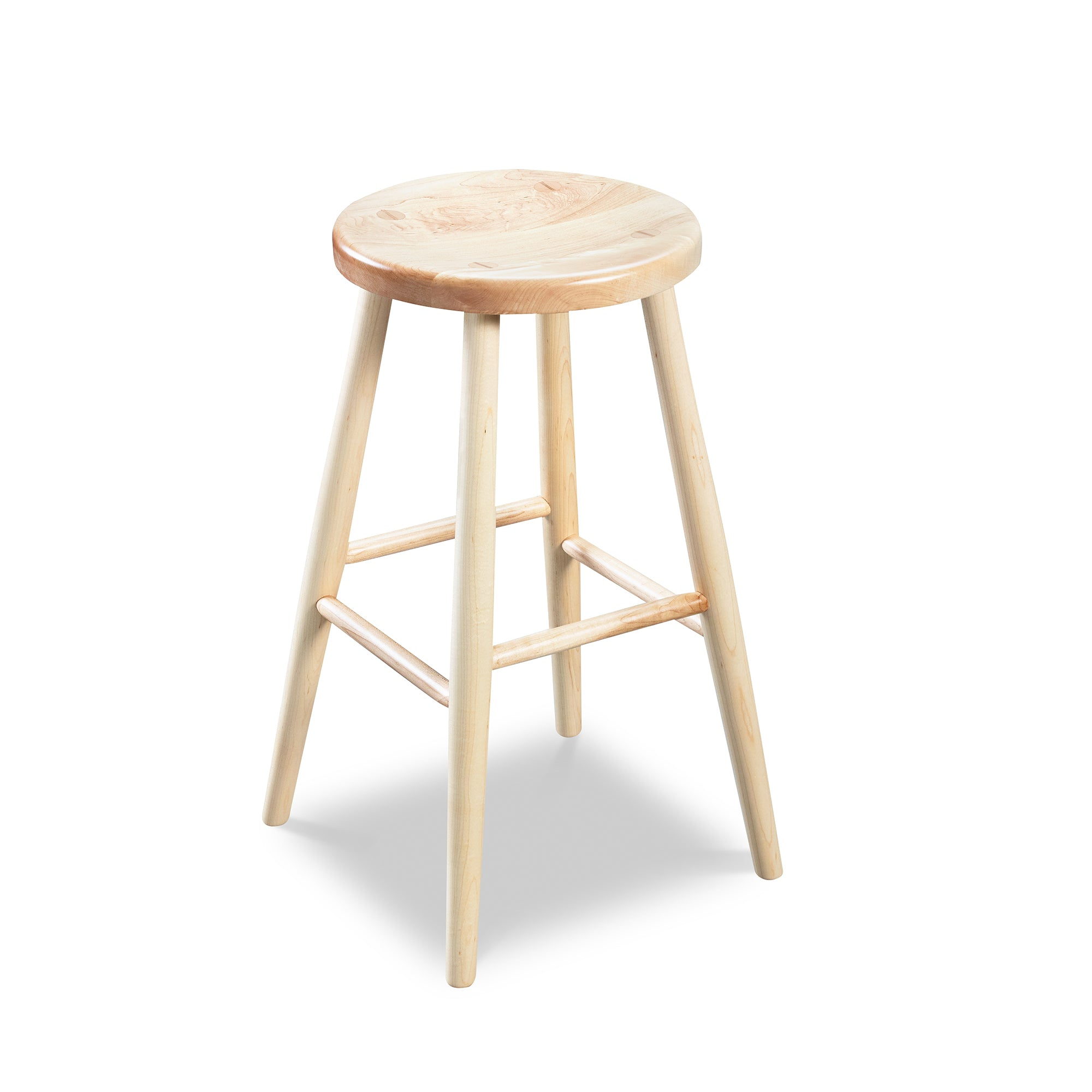 Simple round solid maple wood stool, from Maine's Chilton Furniture Co.