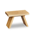 Solid white oak wood step stool with angled legs.