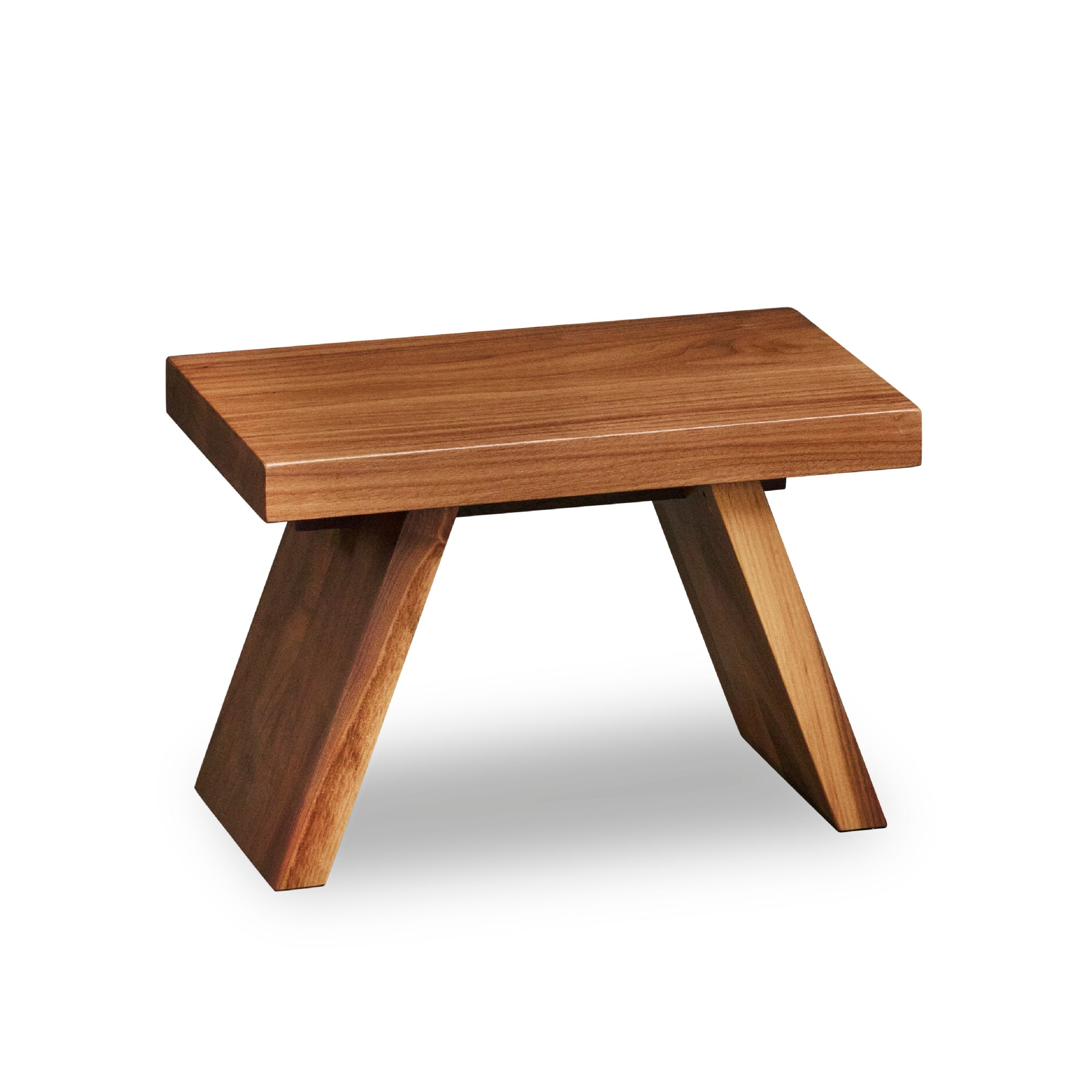 Solid walnut wood step stool with angled legs.