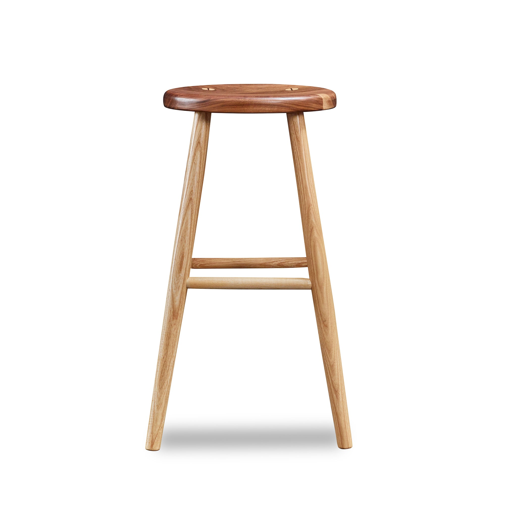 Simple round solid ash and walnut wood stool, from Maine's Chilton Furniture Co.