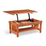 Solid cherry wood mission style coffee table with low shelf and top lifted to table height on metal mechanism