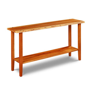 Live edge solid cherry sofa table with four post legs and low shelf, from Maine's Chilton Furniture Co.
