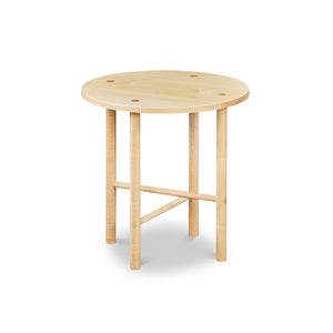 Round Scandinavian style end table with round legs in clear maple