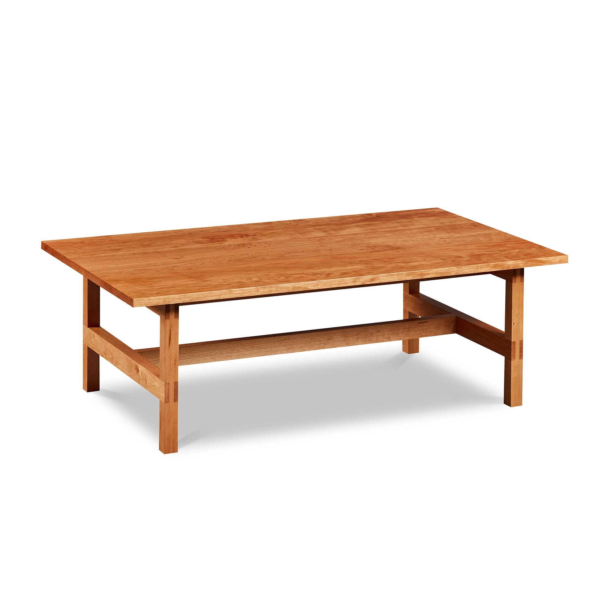 Modern rectangular trestle-style coffee table with visible joinery in cherry, from Maine's Chilton Furniture Co.
