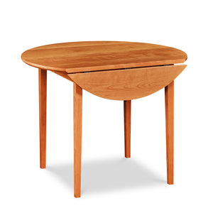Round cherry dining table with with Shaker style tapered legs and drop leaf folded down