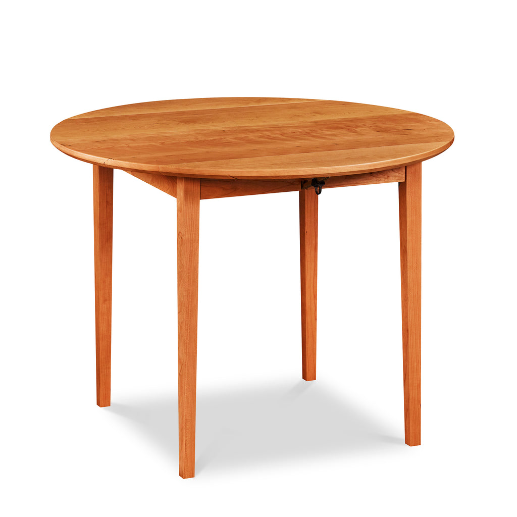 Round cherry dining table with with Shaker style tapered legs