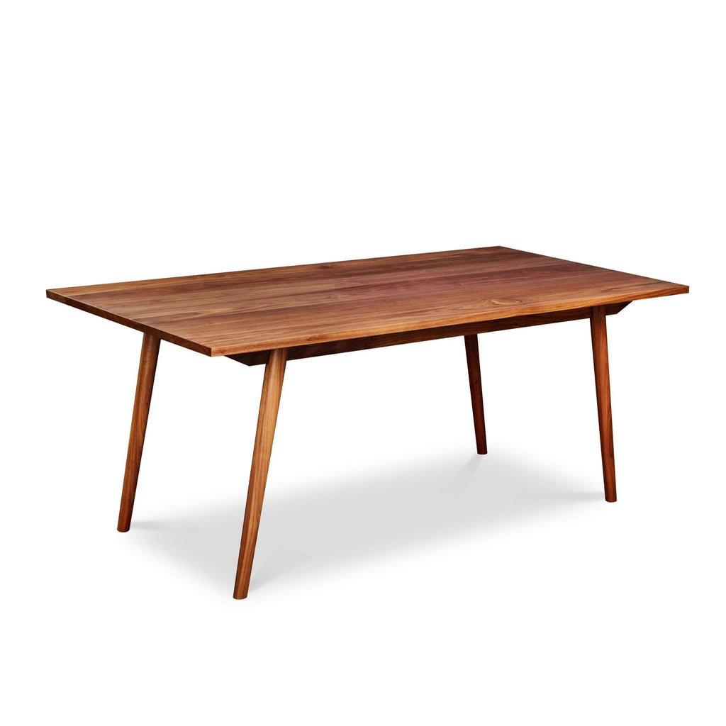 Mid-century Scandinavian rectangle dining table with angled legs in solid walnut wood