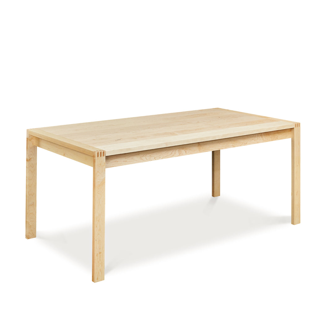 Modern parsons table with visible joinery in maple, from Maine's Chilton Furniture Co.