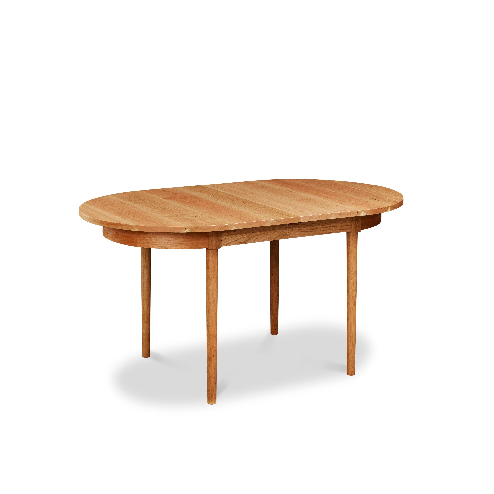 Modern solid cherry oval extension dining table from Chilton Furniture Co. in Maine