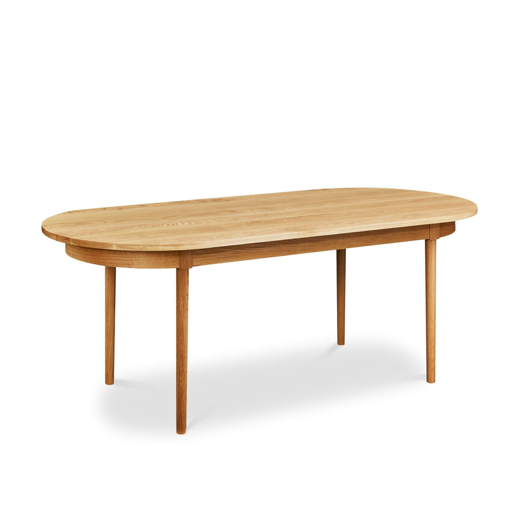 Modern solid white oak oval dining table from Chilton Furniture Co. in Maine