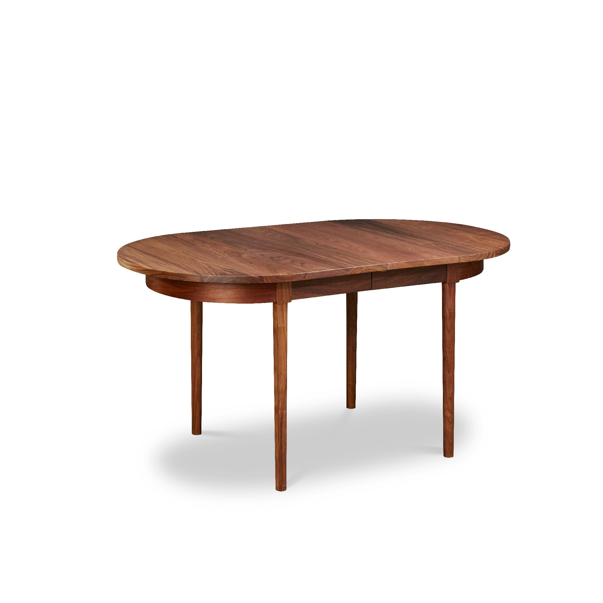 Modern solid walnut oval dining table from Chilton Furniture Co.
