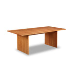 Modern handcrafted wood dining table with panel style legs in solid cherry.