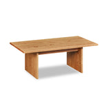 Modern handcrafted wood coffee table with trestle panel style legs in solid cherry