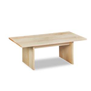 Modern handcrafted wood coffee table with trestle panel style legs in solid clear maple