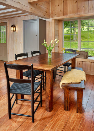 Dining room with classic two-slat Shaker style dining chair, barnboard table and bench
