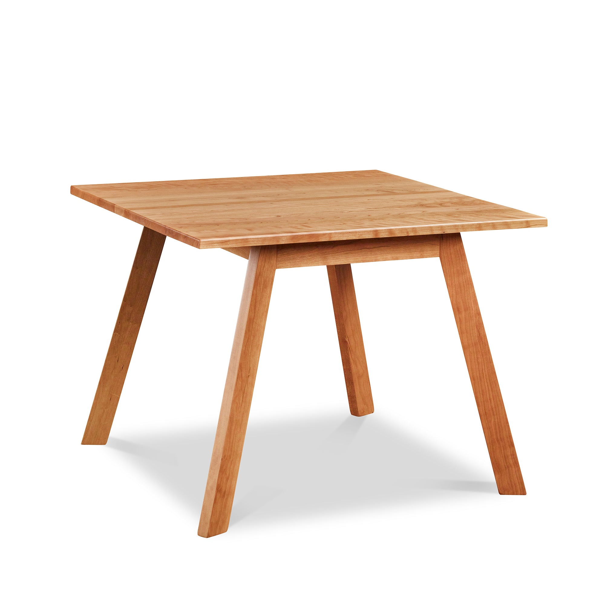 Square modern dining table with angled legs in cherry, from Maine's Chilton Furniture Co.