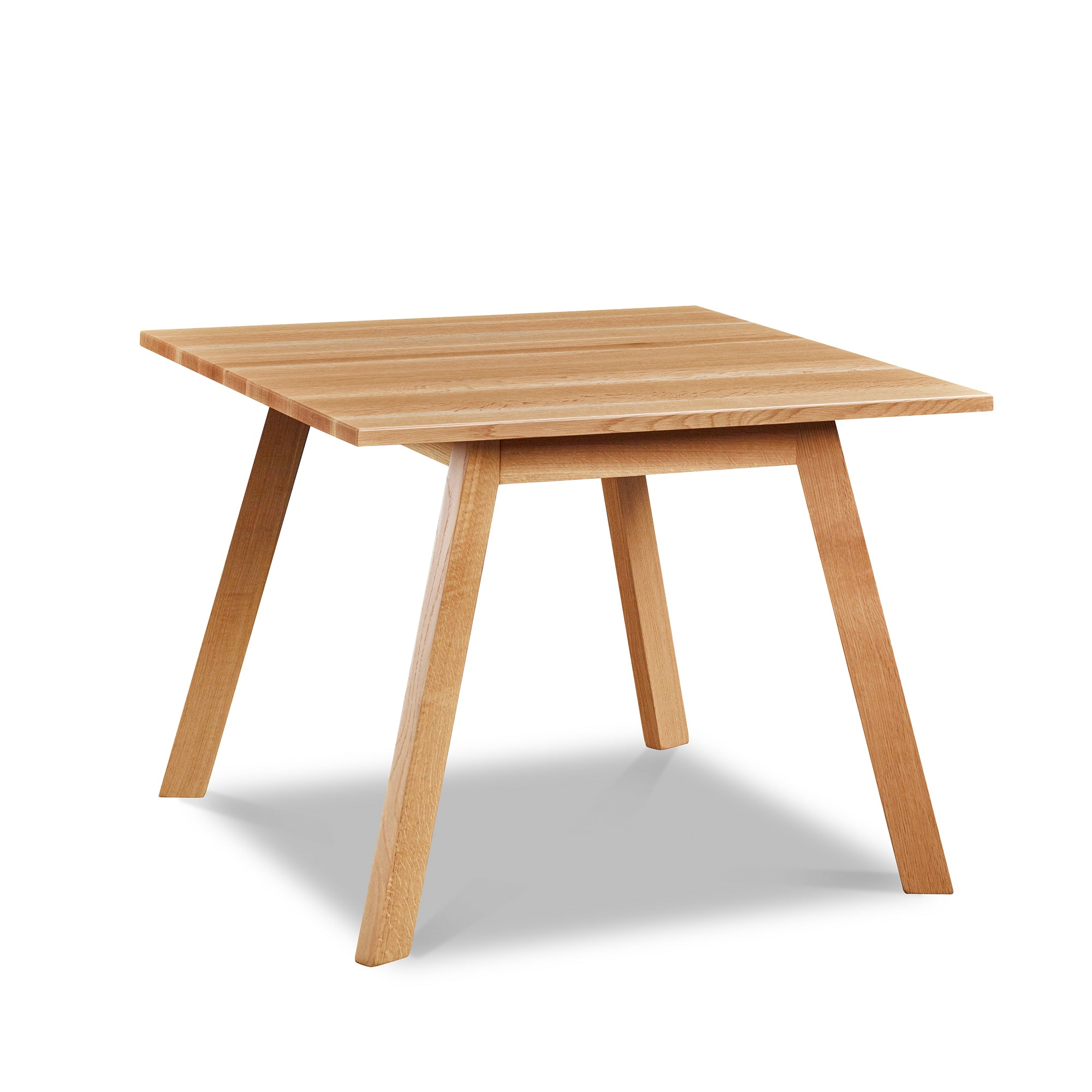 Square modern dining table with angled legs in white oak, from Maine's Chilton Furniture Co.