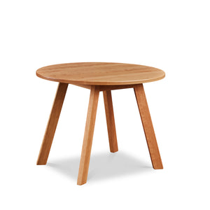 Round modern dining table with angled legs in cherry, from Maine's Chilton Furniture Co.