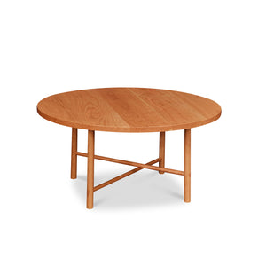 Round Scandinavian style coffee table with round legs in cherry