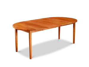 Solid cherry wood extension table with tapered Shaker legs and oval top from Maine's Chilton Furniture Co.