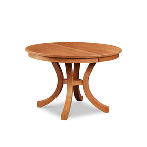 Cherry Prouts Neck pedestal dining table with flared legs, from Maine's Chilton Furniture Co.