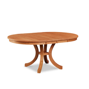 Cherry Prouts Neck extension dining table with flared legs and two leaves in, from Maine's Chilton Furniture Co.