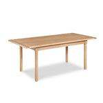 Modern Revelry dining table with straight turned legs and breadboard ends, built in solid white oak
