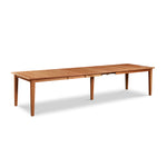 Large Shaker style cherry wood extension dining table with four leaves and extra leg in center for support from Maine's Chilton Furniture Co.