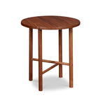 Round Scandinavian style end table with round legs in walnut