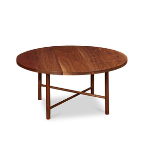 Round Scandinavian style coffee table with round legs in walnut