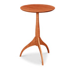 Small, round cherry table with three legs